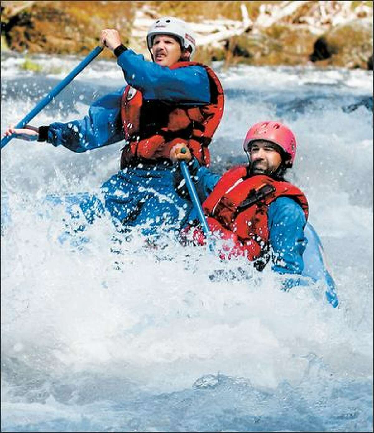Guy Cooper and Jerry Landry steer through the rapids. Landry, right, calls it