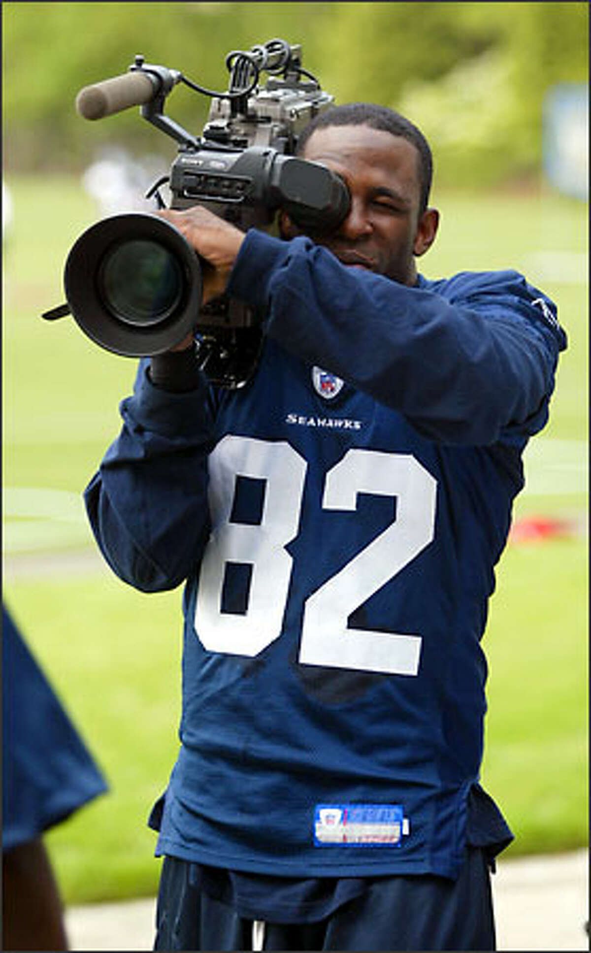 Darrell Jackson, left, turns one of the media's TV cameras on his teammates after mini-camp Friday.