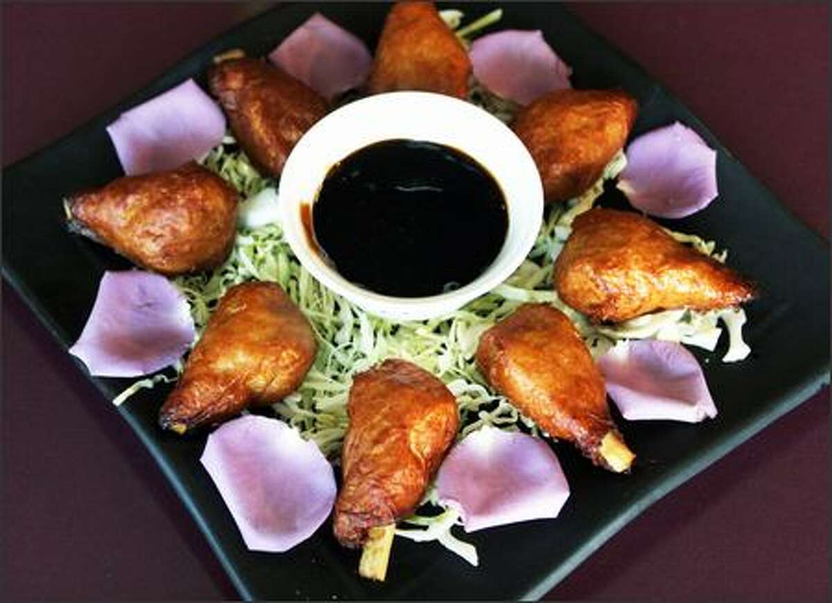 One of Teapot Vegetarian House's specialties is Rose Chicken, drummettes of gluten and tofu wrapped around sticks of sugar cane. It's served with a rose sauce.