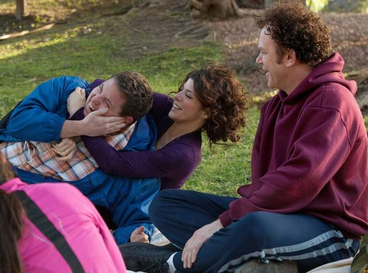 From left, Jonah Hill as Cyrus, Marisa Tomei as Molly and John C. Reilly as John in