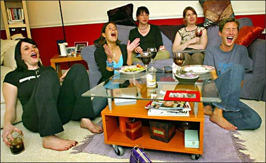 """At the weekly """"Girl Jam,"""" Bradi Jones, from left, Kristin Wright, Lena Pederson, Erin Dolan and Dulci Frank watch the penultimate episode of """"Friends."""" Photo: Grant M. Haller, Seattle Post-Intelligencer / Seattle Post-Intelligencer"""