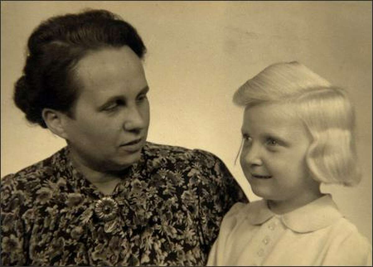 This family photo from around 1945 shows Alodia Witaszek, right, posing with her adoptive German mother, Luise Dahl, who made to send to her Nazi officer husband in Paris to show him the girl she had adopted from the Lebensborn association, believing she was an orphaned German. Nearly four years later, Dahl would receive a letter from the Polish Red Cross asking for the girl to be returned to her rightful family in Poznan, Poland. (AP Photo/Courtesy of Witaszek Family)