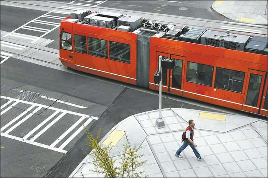 The South Lake Union streetcar goes through the intersection of Ninth Avenue North and Westlake Avenue North. Photo: Andy Rogers, Seattle Post-Intelligencer / Seattle Post-Intelligencer