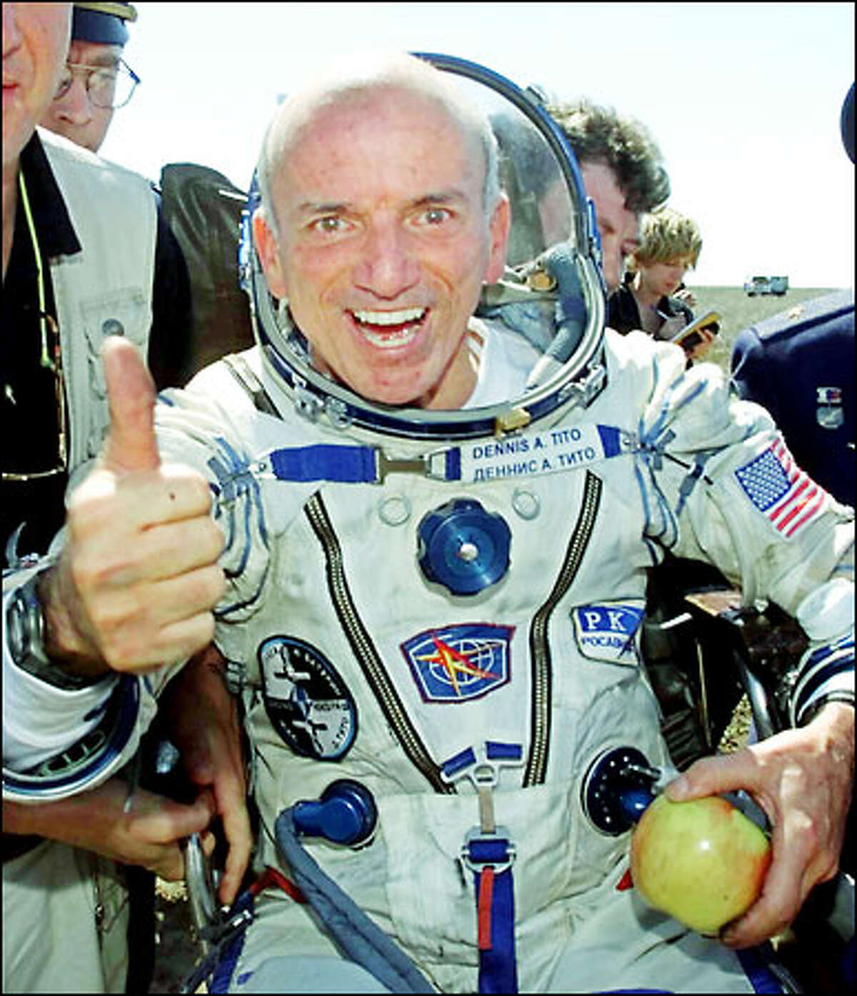 American multimillionaire Dennis Tito, 60, gives his seal of approval shortly after his landing yesterday about 50 miles northeast of Arkalyk, Kazakstan.