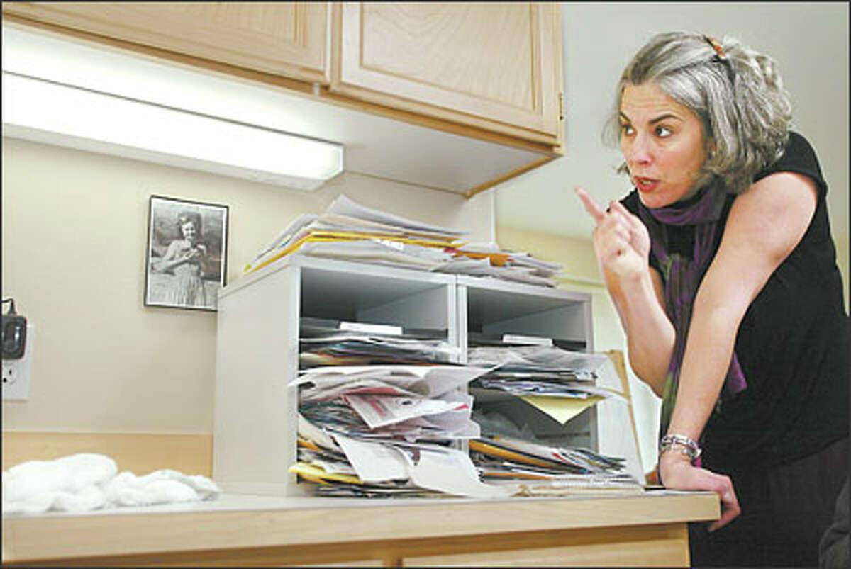 De-clutterer Jessica Duquette directs the cleanup.