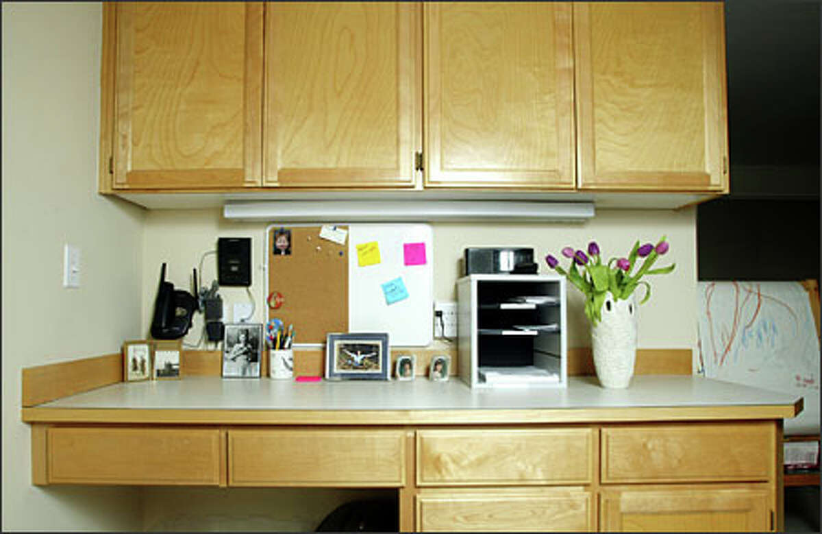 After three hours of working side by side with professional organizer Jessica Duquette, Denn's kitchen office is freed from an overwhelming mess.