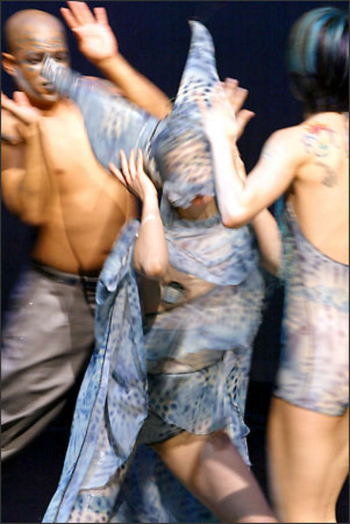 Choreographer Maureen Whiting, center, created a performance that plays off of David Bowie's glamrock style and interest in otherworldly beings. With her are Matthew Reynolds, left, and Michele Steinwald.