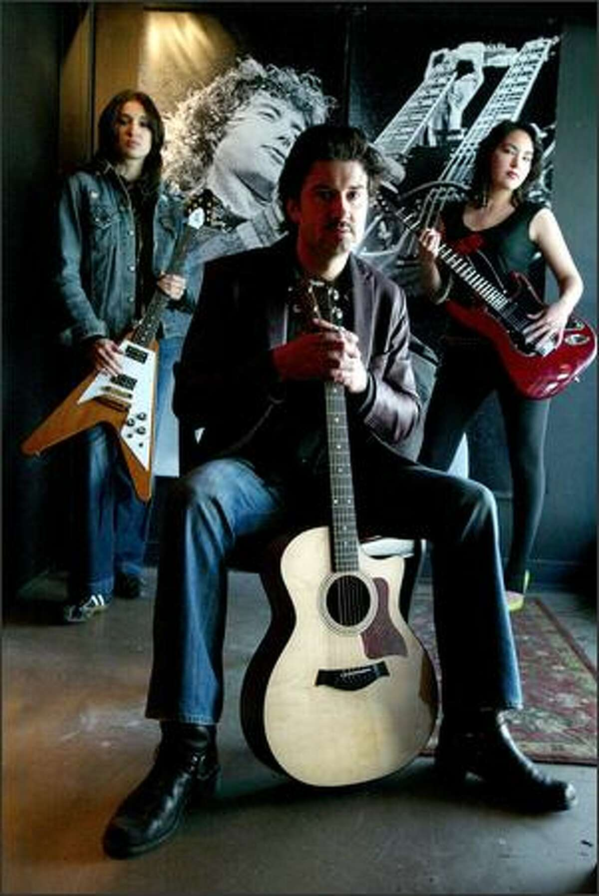 Owner Randy Parsons operates his Parsons Guitar Shops with Dagna Barrera, left, and Natalia Siragusa.