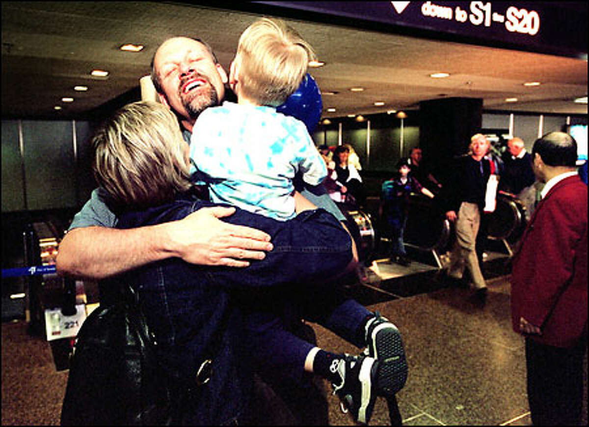 Steve Powers, returning from Greenland, is greeted by wife Winifred and son Taylor, 3, at Sea-Tac Airport yesterday.