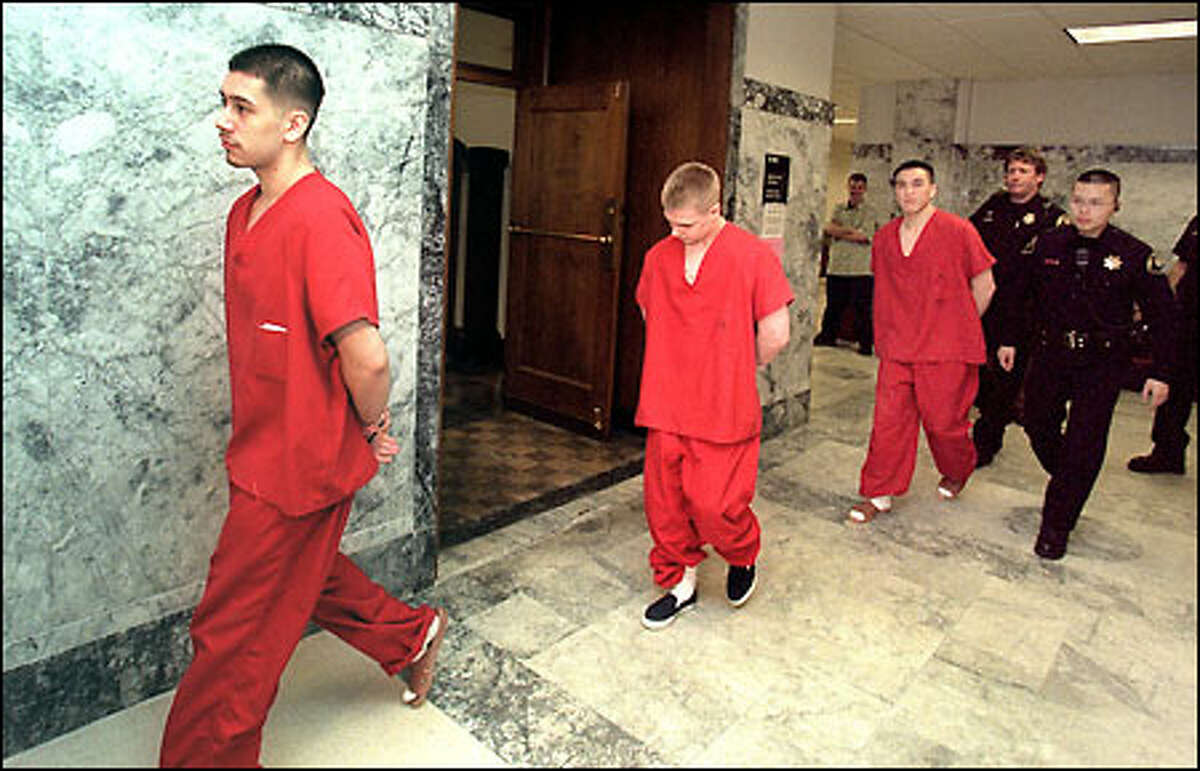 Alex Bremmeyer, left, Miles Skagen and Gabriel Acena walk to Superior Court Judge Richard Jones' courtroom yesterday afternoon.