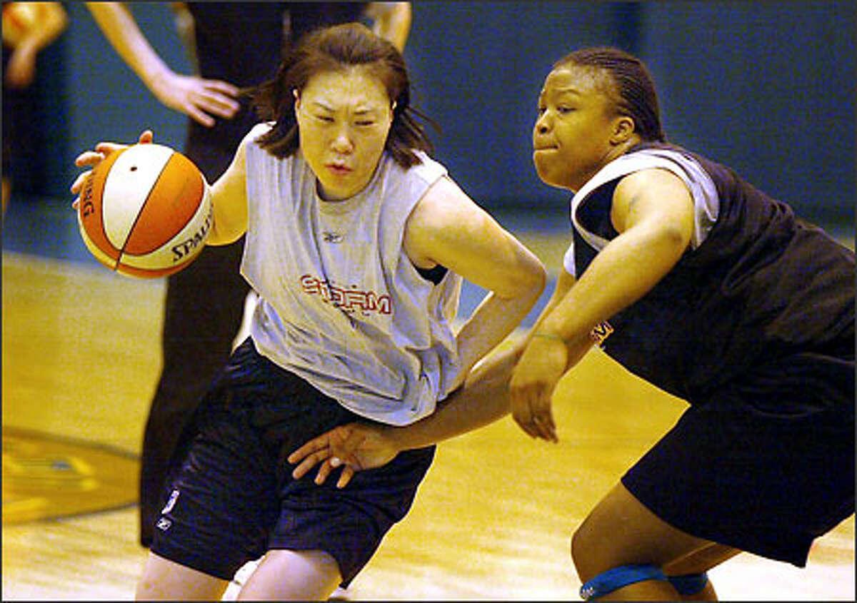 Jung Sun-Min, the Storm's top draft pick, drives against Takeisha Lewis. Jung will be asked to play more on the perimeter.