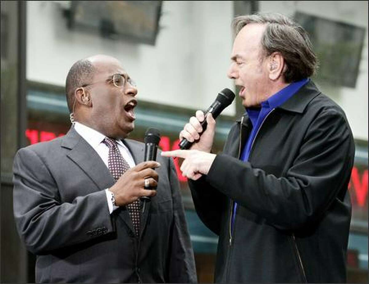 Al Roker, left and Neil Diamond sing a duet during Diamond's appearance on the