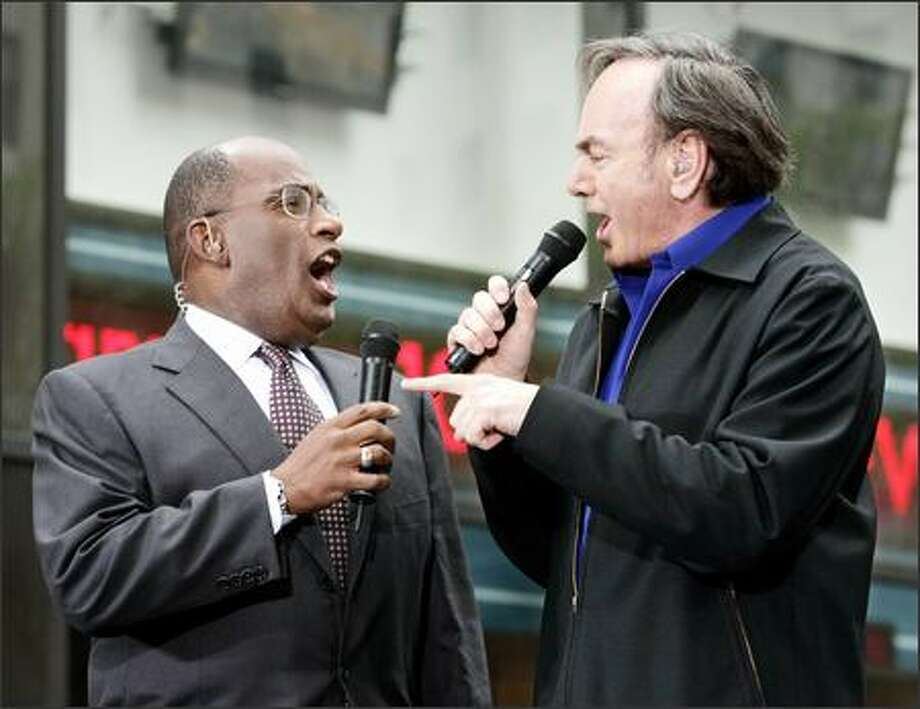 "Al Roker, left and Neil Diamond sing a duet during Diamond's appearance on the ""Today"" show. The Friday concert kicked off the show's summer concert series in New York City's Rockefeller Center. The singer presented Roker with a purple, sequined jacket for his efforts. Photo: Associated Press / Associated Press"