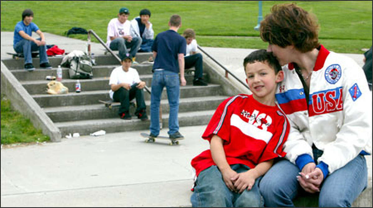 Mitchie breaks from practice to sit with his mom, Jennifer Brusco, at the skateboard park in Kirkland, one of the places he first learned the sport.