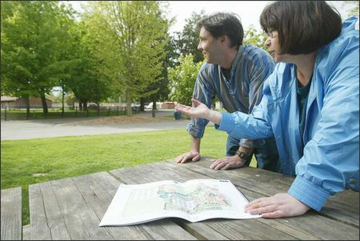 John Havard and Irene Wall live near Woodland Park Zoo and oppose the proposed parking garage, which would be situated in the center left of this photograph, between the meadow where the zoo stages concerts and Phinney Avenue North.