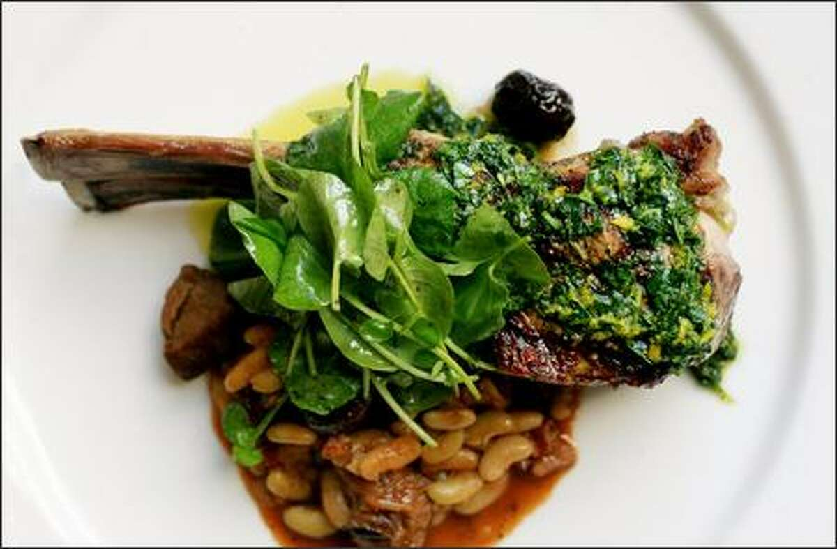 Chef Jamie Guerin combines local grilled rack and braised leg of lamb with white beans, olives, orange and watercress ($32) at the Whitehouse-Crawford restaurant in Walla Walla.