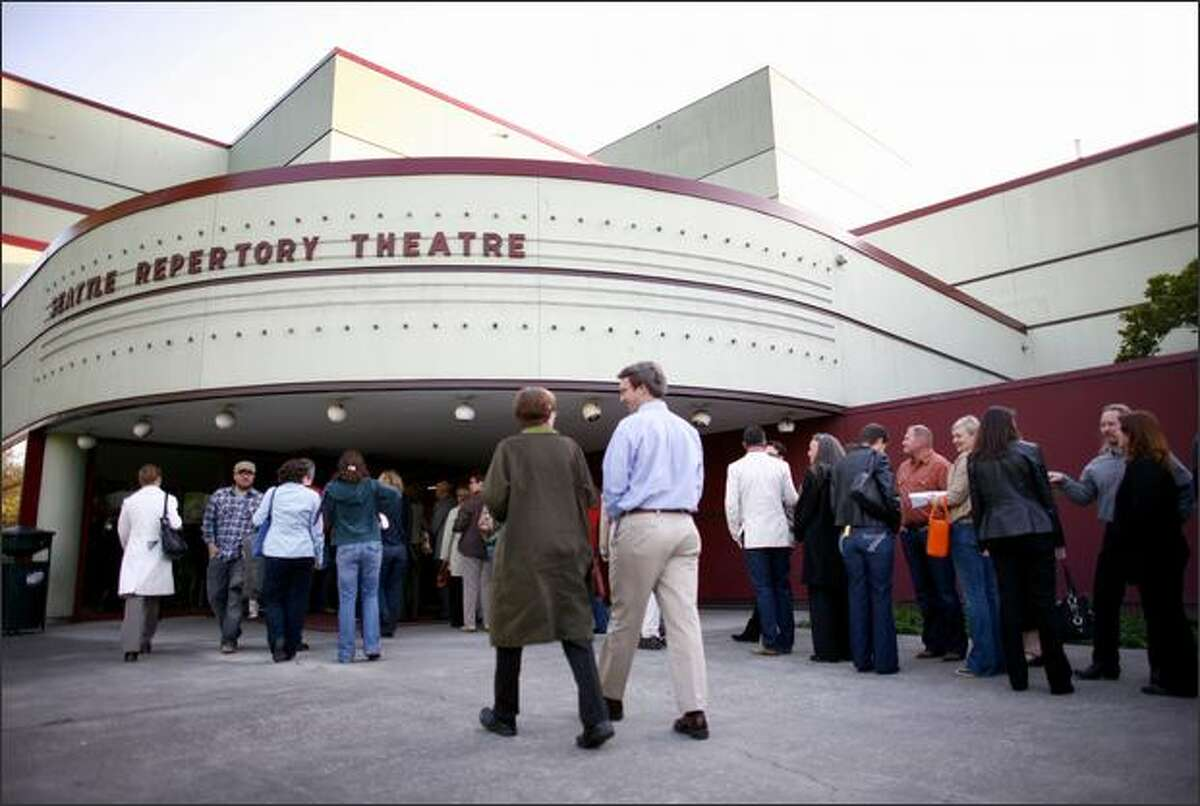 People line up to get into the Seattle Repertory Theater in Seattle on Friday for an evening showing of
