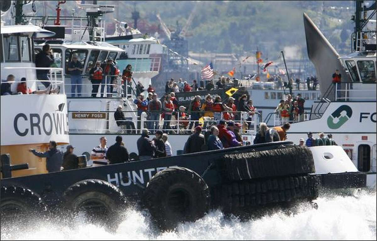 The Crowley Marine Services' tug Hunter steams past the competition during the class A unlimited race on Saturday during the Maritime Festival along the Seattle waterfront.