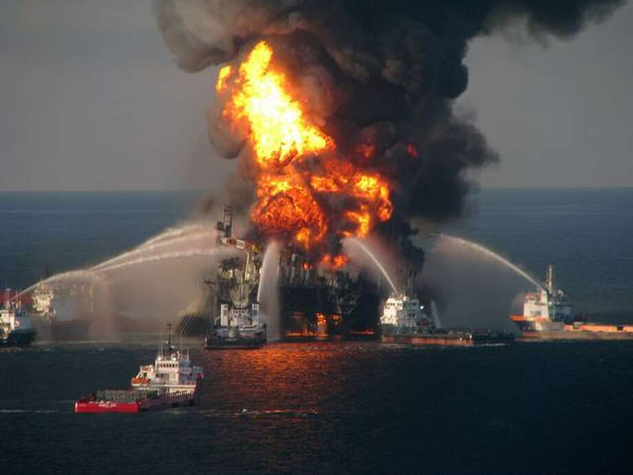 In this handout image provided by the U.S. Coast Guard, fire boat response crews battle the blazing remnants of the offshore oil rig Deepwater Horizon in the Gulf of Mexico on April 21. Multiple Coast Guard helicopters, planes and cutters responded to rescue the Deepwater Horizon's 126-person crew. Photo: Getty Images / Getty Images