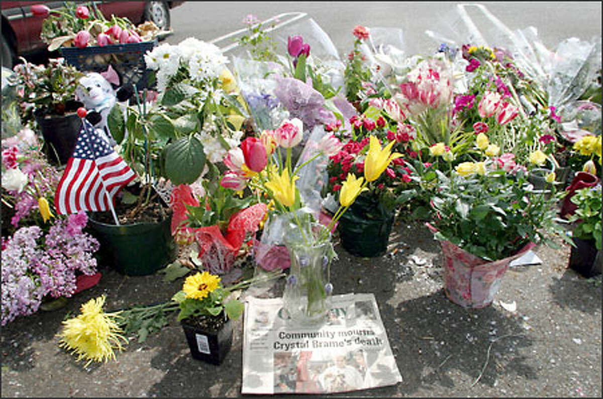 A memorial in the Gig Harbor parking lot where Crystal Brame was fatally shot by her husband, Tacoma Police Chief David Brame, continues to grow on the day of her funeral in Gig Harbor. Crystal Brame died a week after the April 26 fatal shooting by her husband, who commited suicide.