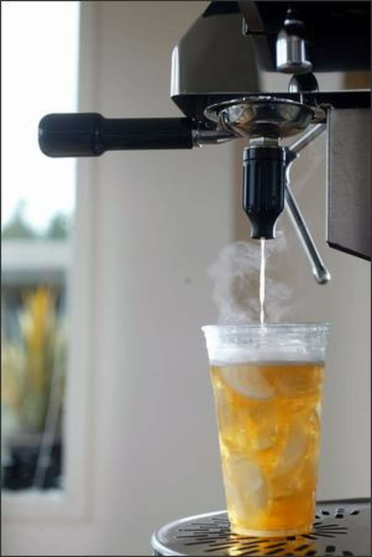 4/4/04 affinitea:: Michael DiMartino developed a beverage infuser which takes large high quality tea, opens the leaf, and extracts the tea through the use of a pressurized chamber. This machine can make tea in 30 - 40 seconds and can give a customer a higher quality product.