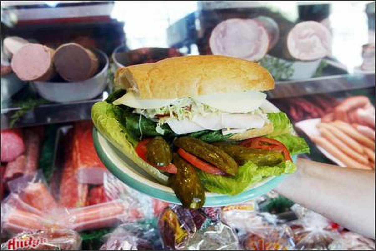 A turkey-and-provolone sandwich is one of many combinations you can order; George's offers 10 meat choices for its big sandwiches.