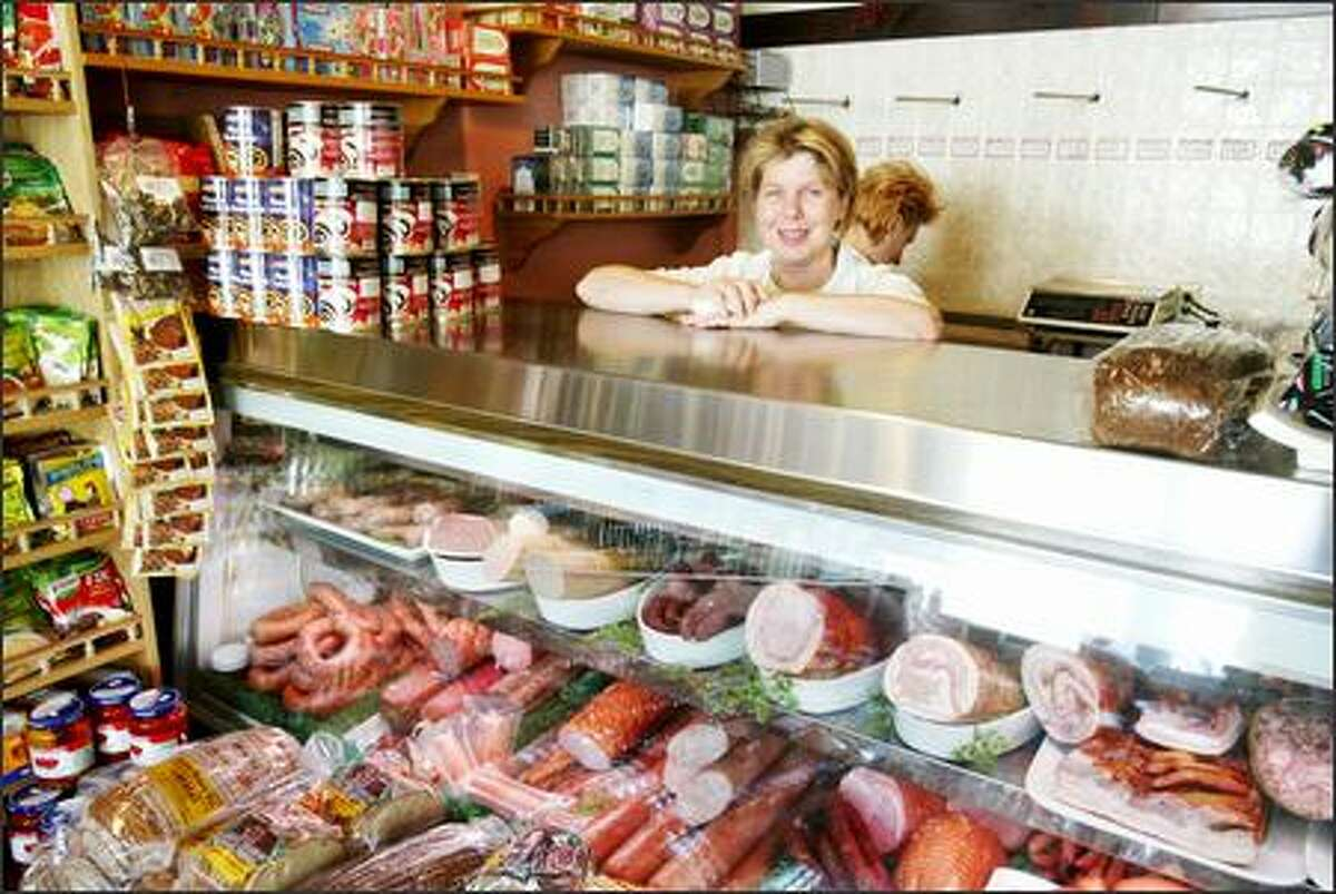 Owner Janet Lidzbarski also works behind the meat counter at George's Sausage and Delicatessen.