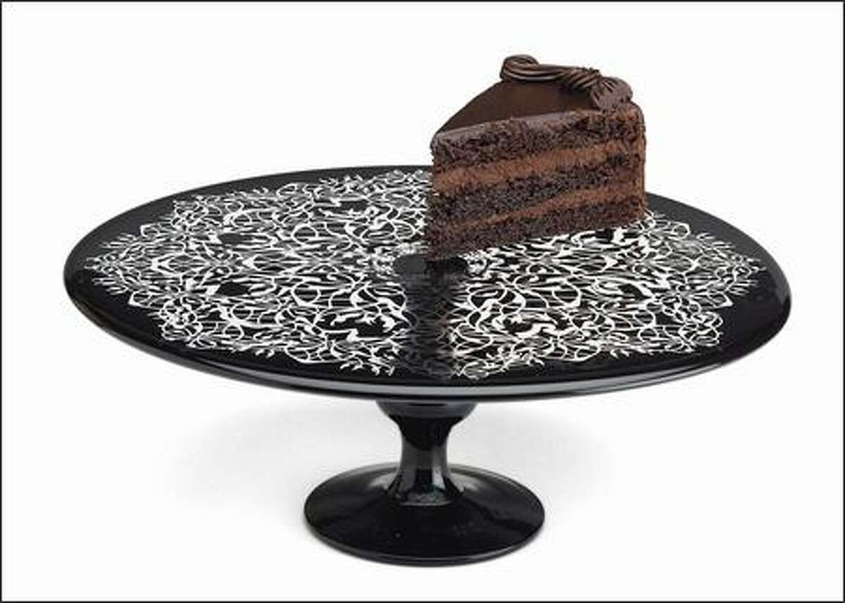 An intricate lace pattern etched onto black glass gives this cake stand a granny-goth vibe. $60. Museum of Modern Art.