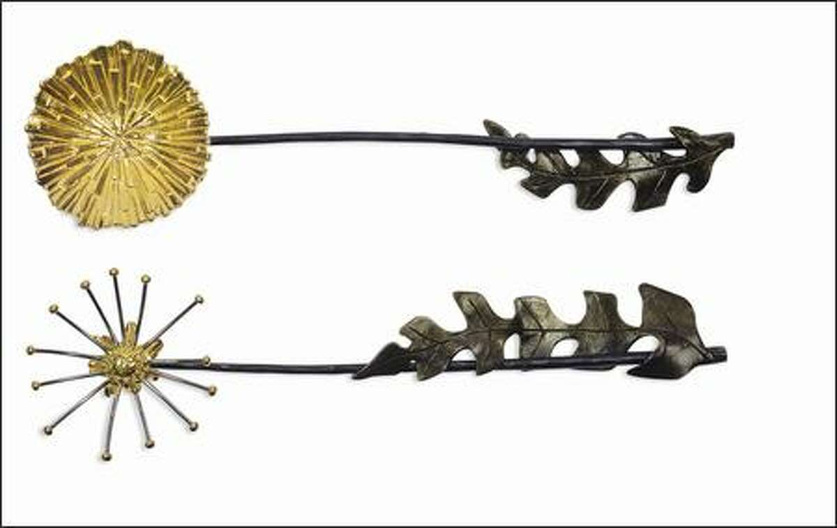 This delecate dandelion serving set is the latest work of Michael Aram. Gold plate and oxidized bronze. $149. Bellevue Arts Museum.