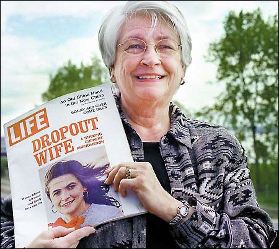 Now a grandmother and remarried, Wanda Adams recently posed with a copy of the March 1972 edition of Life magazine that made her a poster child -- and a lightning rod -- for the women's movement. Photo: Renee C. Byer, Seattle Post-Intelligencer / Seattle Post-Intelligencer