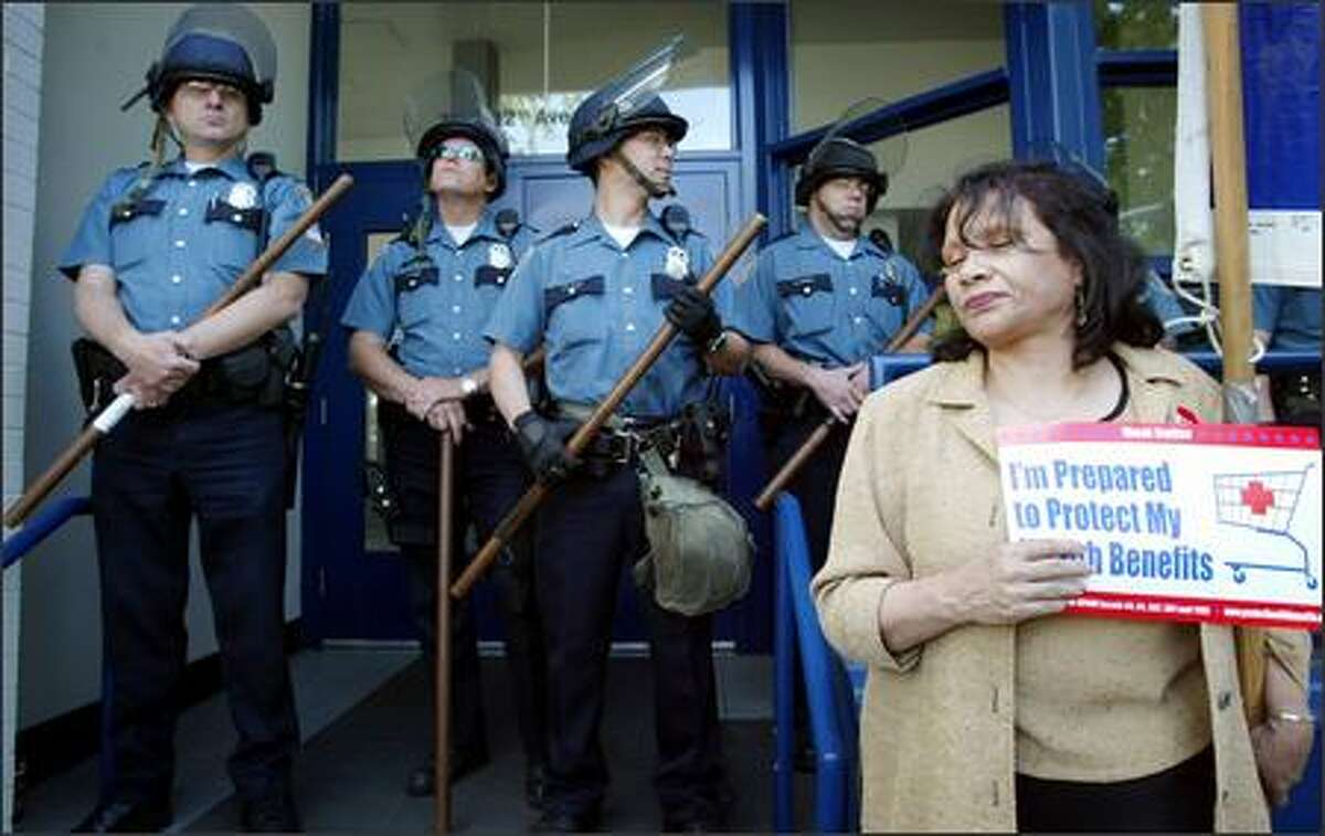 Grocery union member Cynthia Bell joins a protest at the Seattle police precinct on Capitol Hill yesterday, where the crowd sought the release of a state union official who was arrested at an earlier rally at a Safeway store. The union is trying to highlight opposition to company proposals.