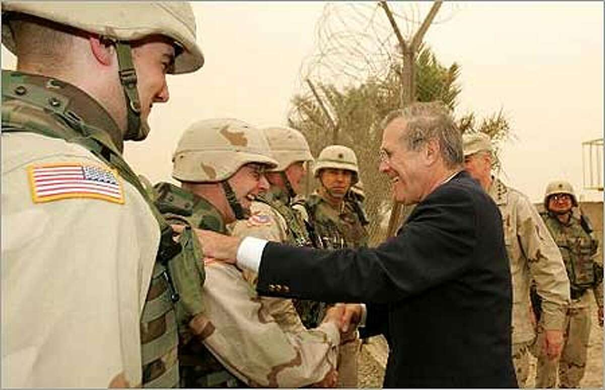 U.S.Defense Secretary Donald H. Rumsfeld greets U.S. Army soldiers as he tours Abu Ghraib prison shortly after his arrival to Baghdad, Iraq, Thursday. (AP Photo/David Hume Kennerly, Pool)
