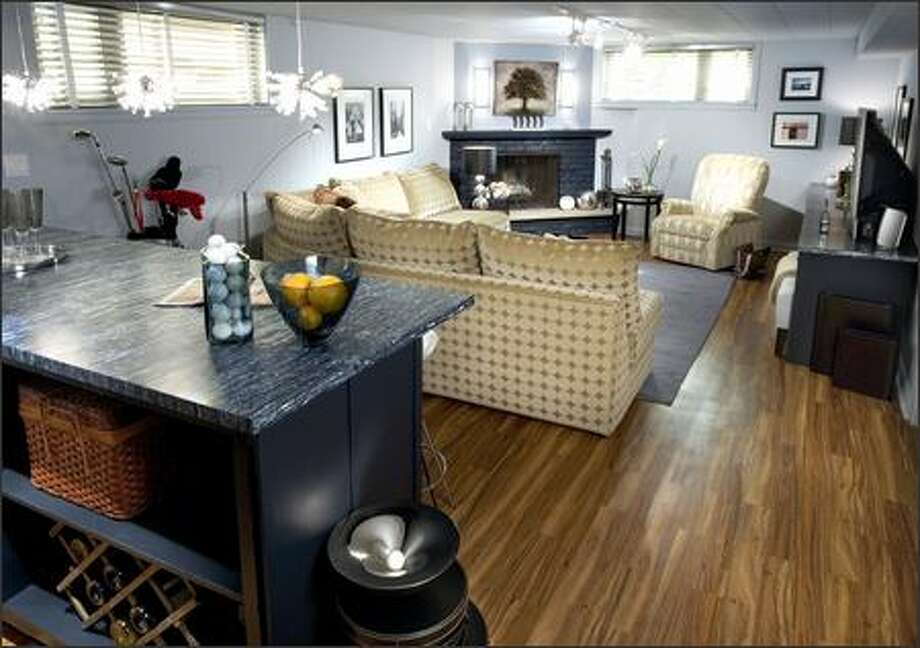 To make this dingy basement a good party spot required tossing out most of the furniture, repainting and putting in a new floor. Photo: HGTV / HGTV