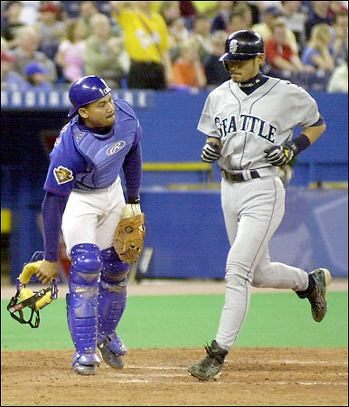 Ichiro Suzuki, passing in front of Toronto catcher Alberto Castillo to score, was a home run from hitting for the cycle both Saturday and yesterday.
