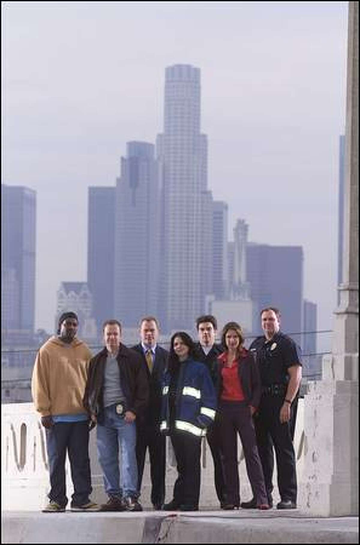 """Pictured: Mykelti Williamson as """"Fearless"""" Bobby Smith, Donnie Wahlberg as Joel Sears, Neal McDonough as David McNorris, Lana Parrilla as Teresa Ortiz, Jason Gedrick as Tom Tucotte, Nina Garbiras as Andrea Little and Gary Basaraba as Ray Hechler in """"Boomtown."""""""