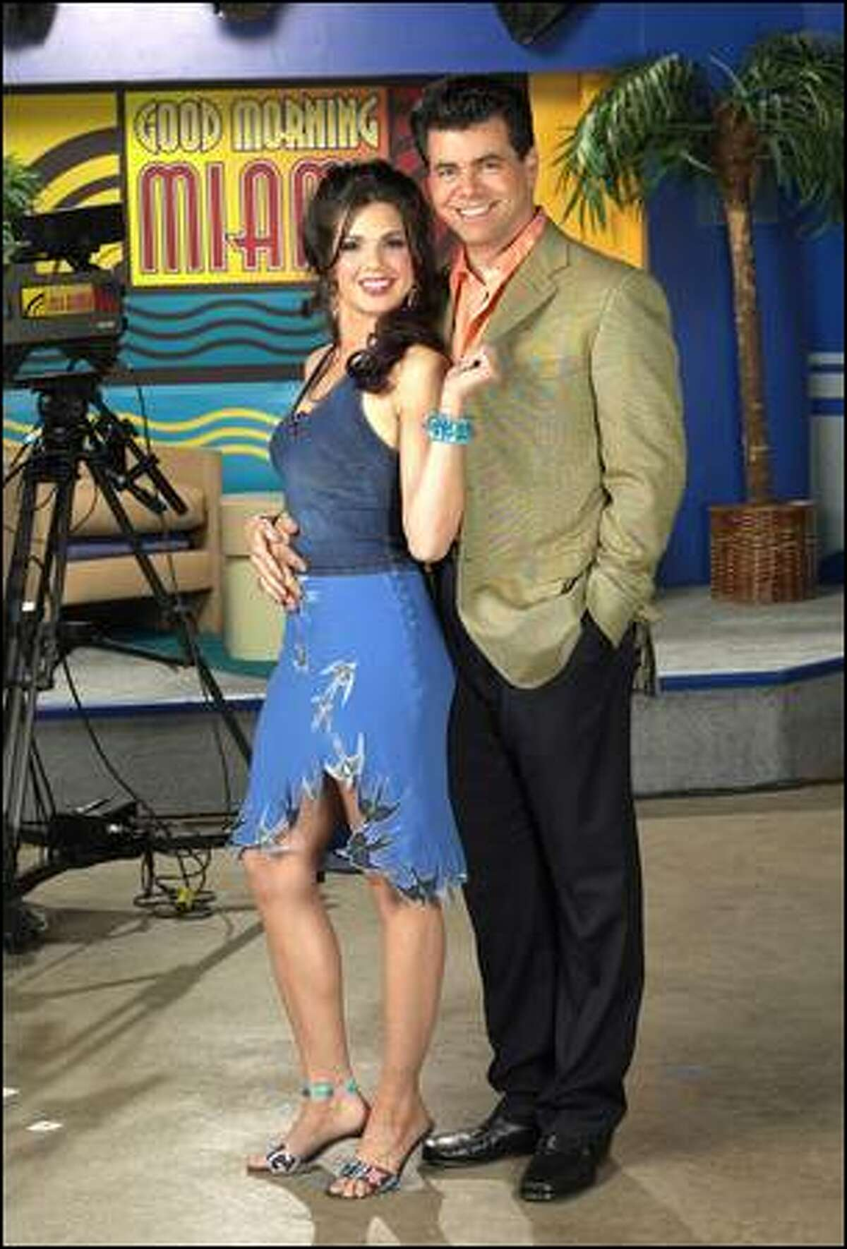 """Pictured: Tessie Santiago as Lucia Rojas-Miller and Burke Moses as Gavin Stone in """"Good Morning Miami."""""""