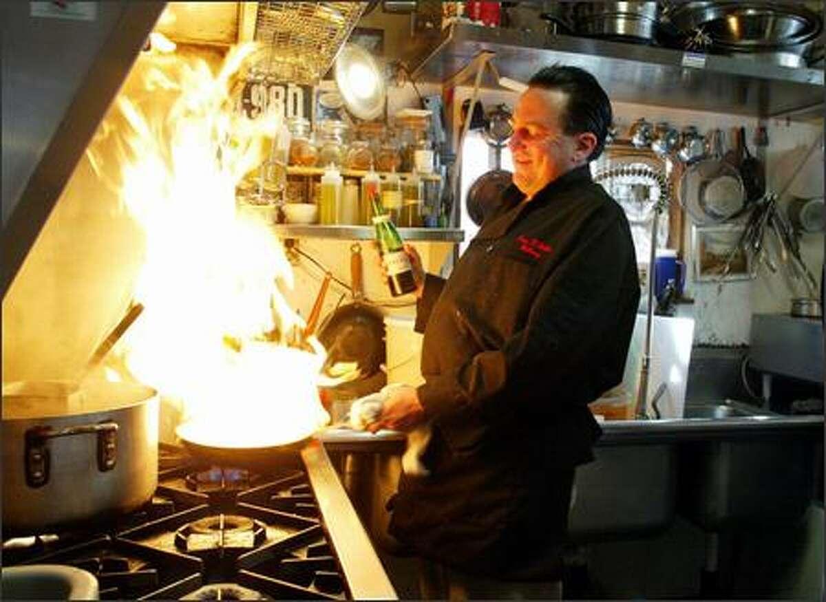 Anthony Donatone prepares a plate of agnello rustico at his Ravenna family restaurant, Casa D'Italia.