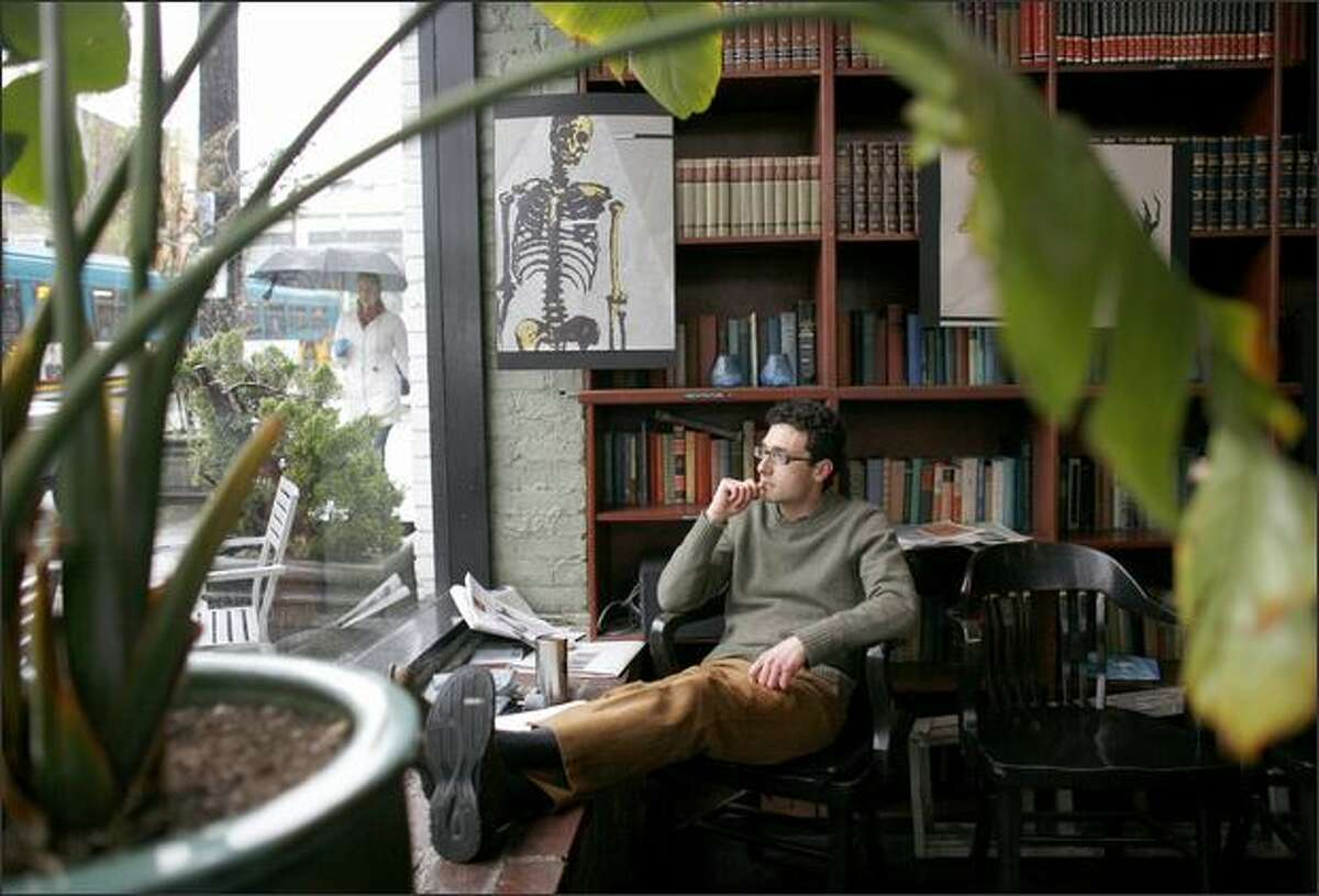 Jerry Romano relaxes at Bauhaus Books and Coffee on East Pine Street in Seattle. Romano has lived in the neighborhood since 1994 and has seen it change dramatically. Bauhaus is an example of the character that some are trying to maintain in the neighborhood.