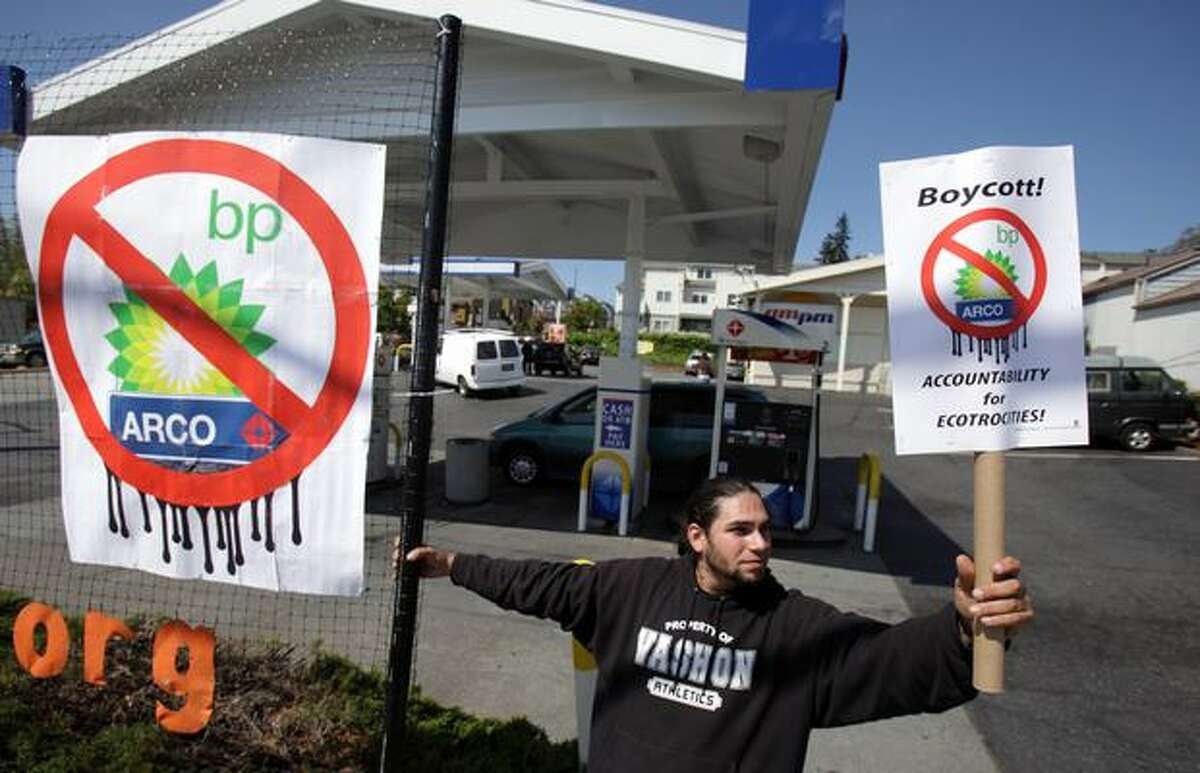 Jared Middlecalf of Vashon Island, Wash. participates in a protest at an ARCO gas station on Friday May 14, 2010 on Aurora Avenue North and North 85th Street in Seattle. Environmental activists gathered at the gas station to call for a boycott of energy company BP as an oil well in the Gulf of Mexico continues to spew oil, weeks after the offshore oil rig Deepwater Horizon exploded and sank, killing 11 workers. Bill Moyer, executive director of the Backbone Campaign - the group that organized the protest - said there has to be a significant price to pay for what he said is an unforgivable mistake.