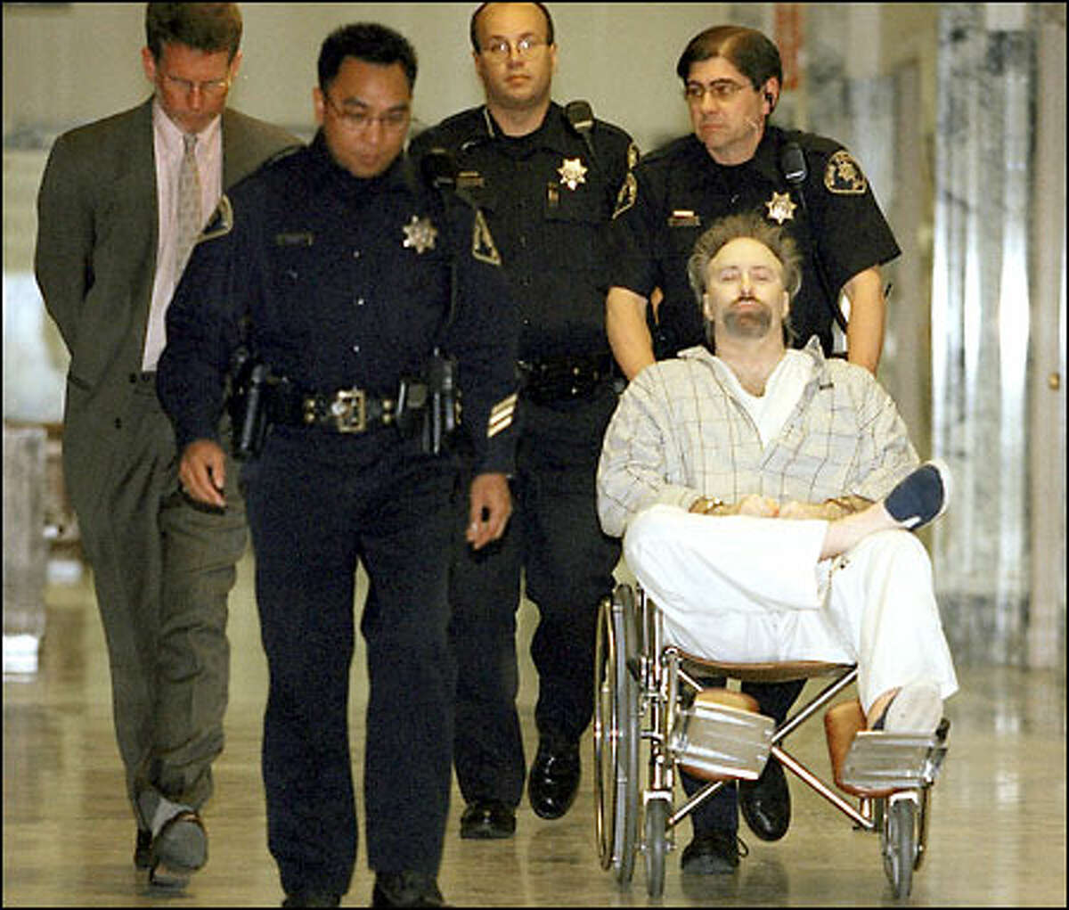 Dayva Cross is wheeled into court yesterday, where he heard a jury sentence him to death for the slayings of his wife and her two daughters.