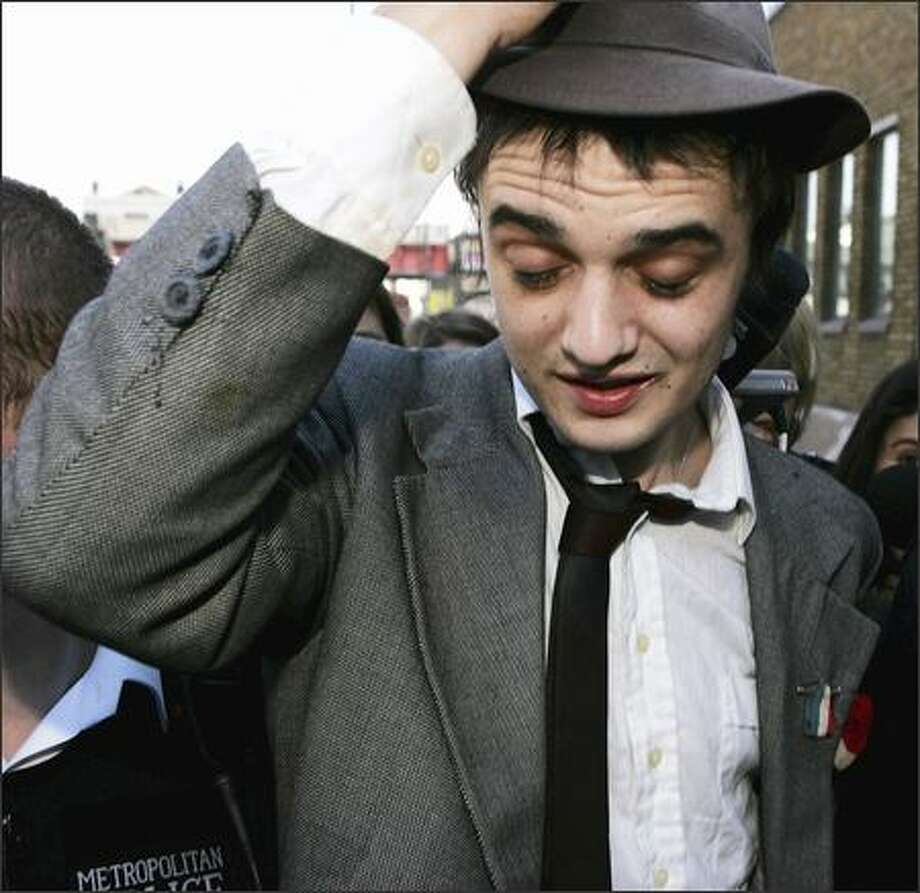 Forget the baby. Pete Doherty's life is a shambles. The U.K.'s The Sun reports that the Babyshambles lead singer shot a syringe of what looked like blood into the camera lens during an interview with MTV News. Cameramen are worried they may have been infected from the splatter. Somebody, drop a net over this guy. Photo: Associated Press / Associated Press