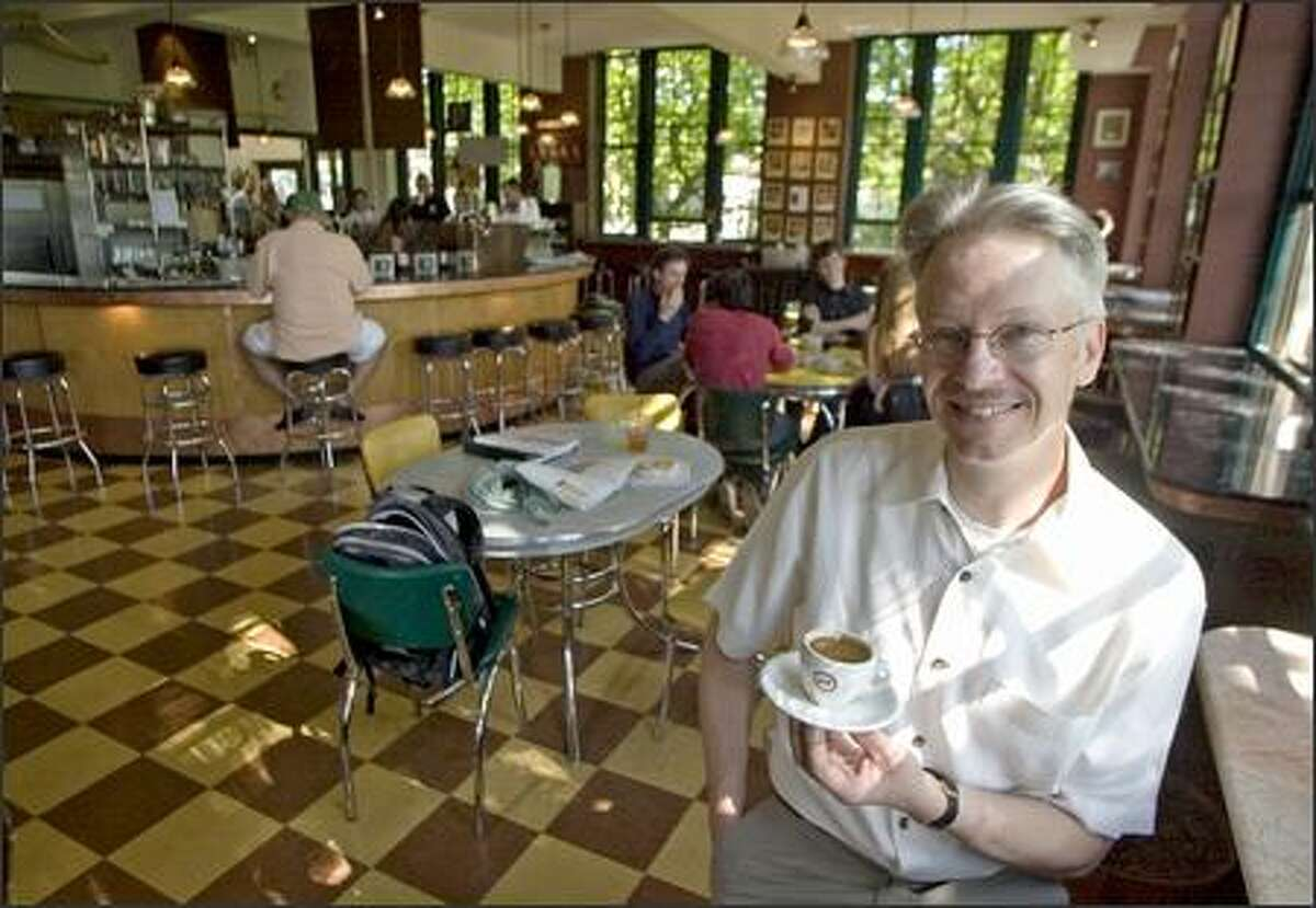 David Schomer holds a cup of espresso, the trademark of his Espresso Vivace coffee shop on Capitol Hill.