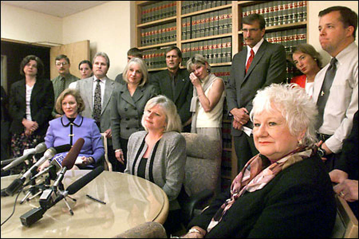 Rosalie Stevenson, foreground, and her family have lobbied for changes in the way the state deals with mentally ill offenders since the stabbing death of her husband in 1997.