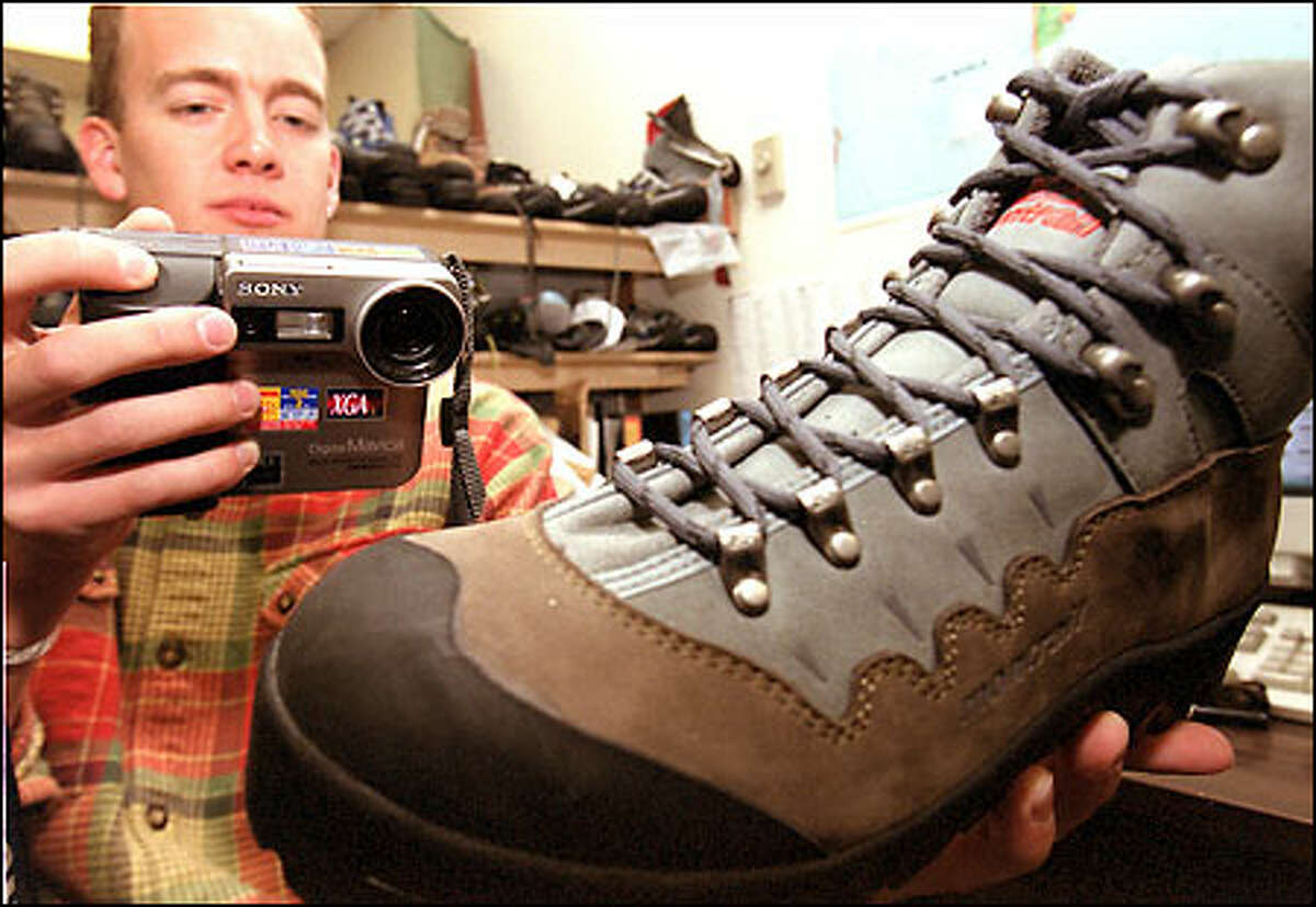 Montrail product manager Jon Fewster takes a tight shot of a prototype boot. REI is among the company's 350 to 400 retail customers.