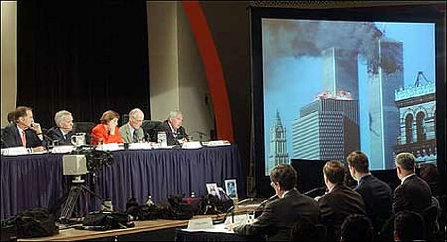 Memebers of the Sept. 11 commission --  Chairman Thomas Kean, Bob Kerry, Jamie Gorelick, Slade Gorton and Fred Fielding, seated left to right on stage --  listen to the staff report on Emergency Preparedness and Response during hearings in New York City Tuesday. (AP Photo/Richard Drew) Photo: Associated Press / Associated Press