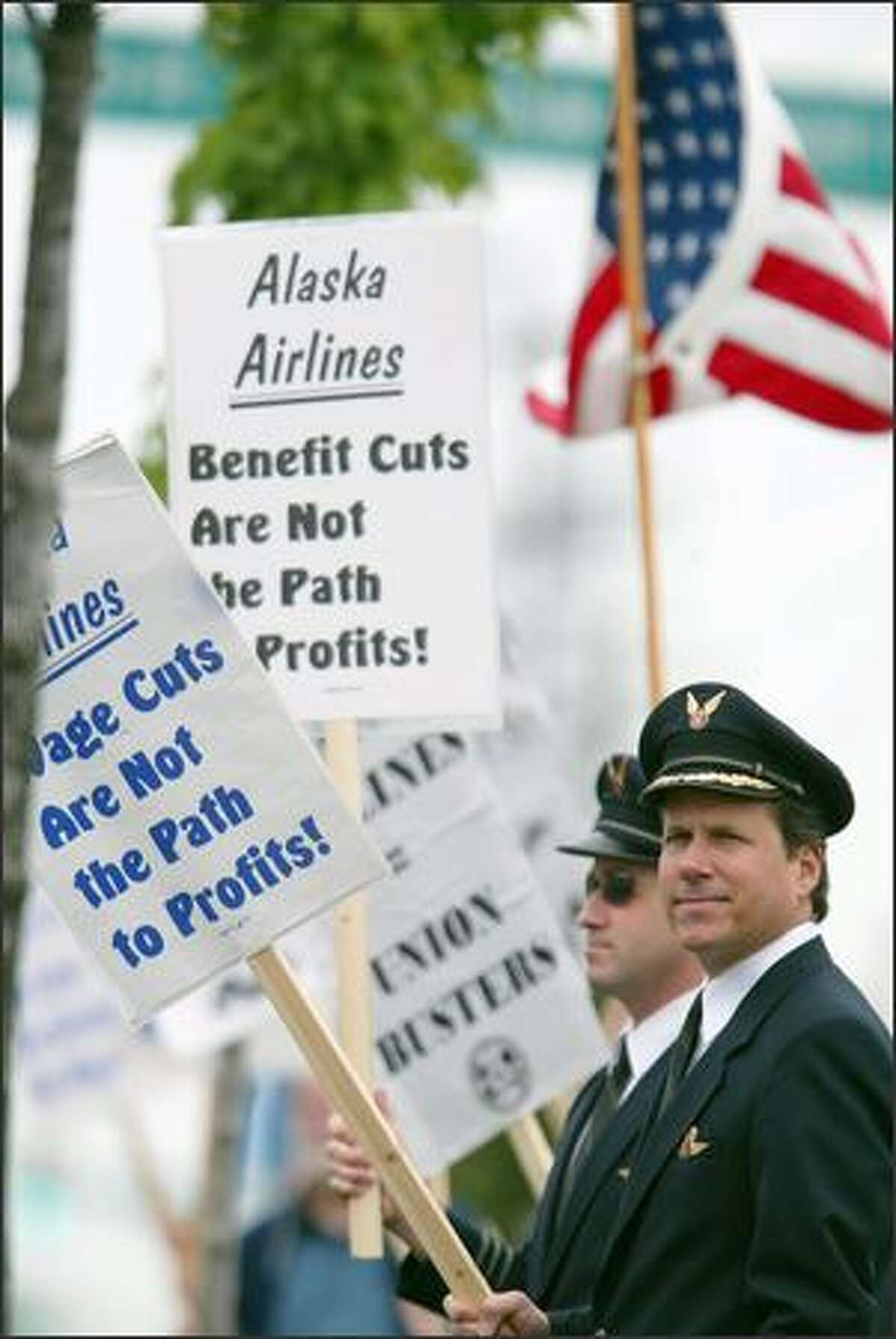 Alaska Airlines pilots Peter Barbin, left, and Glenn Vyskocic joined others picketing outside the annual shareholders meeting yesterday at the Museum of Flight. Employees are upset about layoffs and reduced pay.