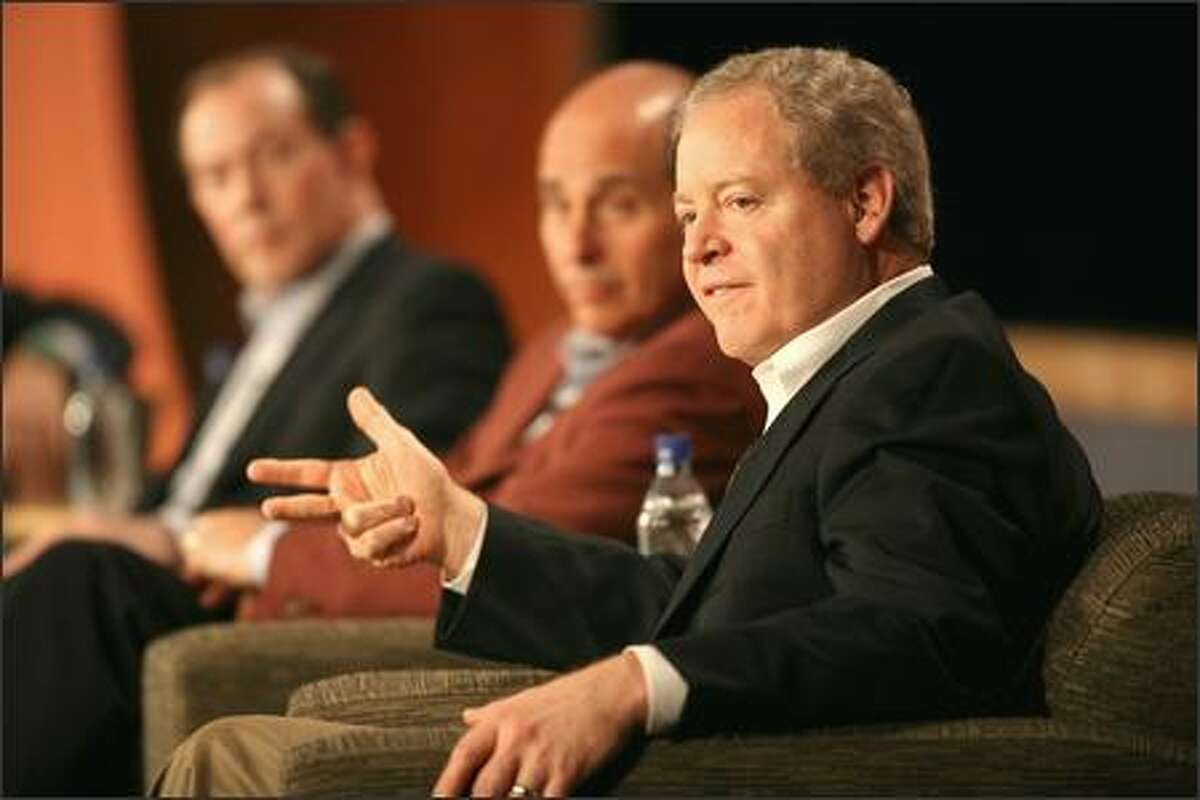 Jim Mulva of ConocoPhillips, right, and Ed Zander of Motorola, center, take part Wednesday in a panel titled