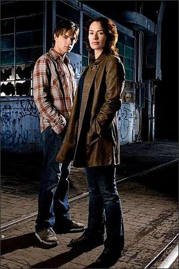 "Lena Headey, right, plays Terminator-fighter Sarah Connor and Thomas Dekker is her son, John, in Fox's ""Sarah Connor Chronicles."" Photo: Fox / Fox"
