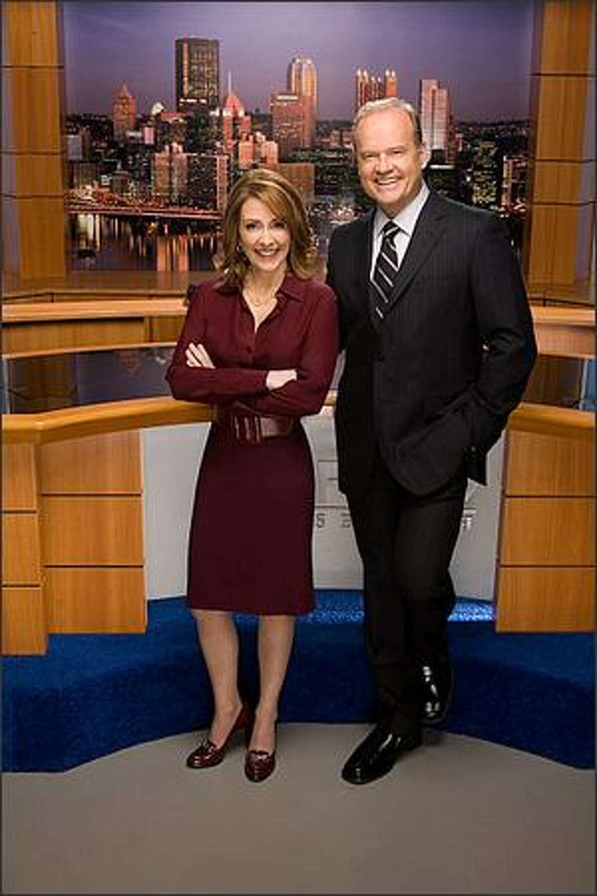 Kelsey Grammer, right, and Patricia Heaton play Pittsburgh news anchors in