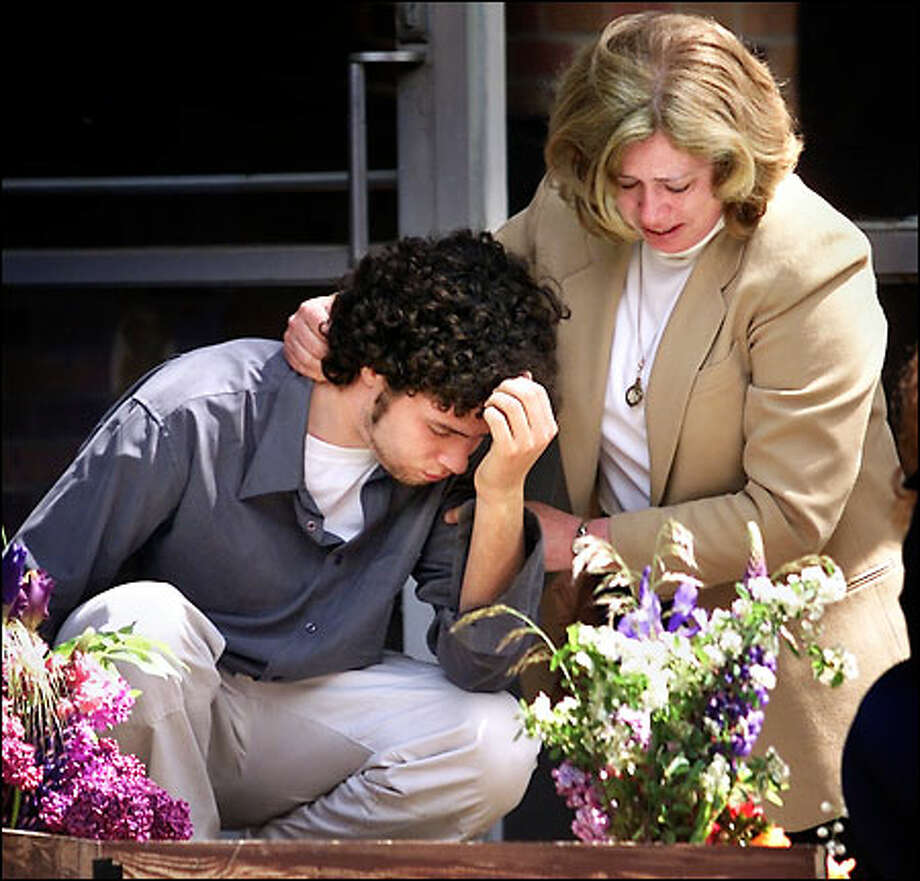 Mark Carr, stepson of James D. Holloway, and his mother, Judy Carr, Holloway's wife, mourn at Pacific Lutheran University yesterday. Photo: Dan DeLong, Seattle Post-Intelligencer / Seattle Post-Intelligencer